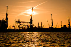 Silhouette of cranes in the harbour Stock Photo