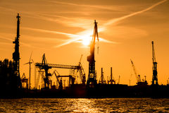 Silhouette of cranes in the harbour Royalty Free Stock Photo