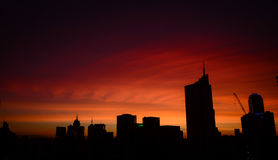 Silhouette of cranes and modern constructions in CBD Royalty Free Stock Photo