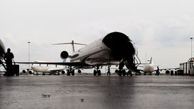 Silhouette of CRJ-1000 bombardier aircraft in hangar on front side Stock Image