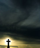 Silhouette of a Cross stock photo