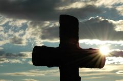 Silhouette of a cross against. Silhouette of a cross  against evening sun Stock Photos