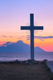 Silhouette of cross and mount Athos at sunrise or sunset with sea panorama Stock Image