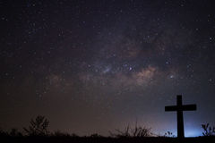 Silhouette of cross over milky way background,Long exposure photograph. stock photography