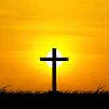 Silhouette of the cross with the sunset. Stock Image