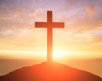 Silhouette of cross. Symbol of God love to people Stock Image