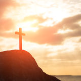 Silhouette of cross. Symbol of God love to people Stock Photo