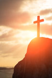 Silhouette of cross. Symbol of God love to people Stock Photos