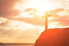 Silhouette of cross. Symbol of God love to people Royalty Free Stock Photography