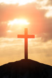 Silhouette of cross. Symbol of God love to people Stock Photography