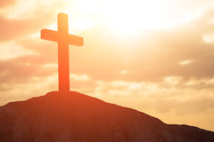 Silhouette of cross. Symbol of God love to people Royalty Free Stock Images