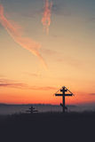 Silhouette crosses at sunset, copy space. The destroyed church Royalty Free Stock Image