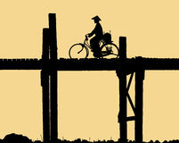 Silhouette crossing the  U Bein bridge Royalty Free Stock Photos