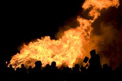 Silhouette of crowd at bonfire. Silhouette of crowd against large bonfire on bonfire night Stock Image