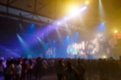 Silhouette crowd in front of concert stage blurred. Photo silhouette crowd in front of concert stage blurred Royalty Free Stock Photography