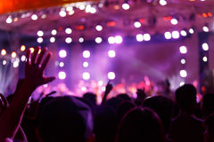 Silhouette crowd in front of concert stage blurred Stock Photography