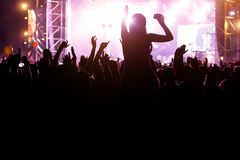 Silhouette of a crowd and girls opposite the scene at the summer music fest stock images