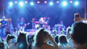 Silhouette crowded of people dancing at a night party concert. stock footage