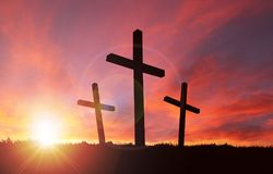 Crucifixion of Jesus With Sunset Sky and Copy Space Royalty Free Stock Image