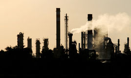 Silhouette  of crude oil refinery station during dusk Stock Photo