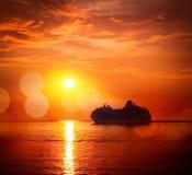 Silhouette of Cruise Ship. Sea Sunset. Bokeh. Royalty Free Stock Photo
