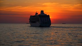 Silhouette of the cruise ship at sunset Stock Images
