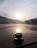 Silhouette cup of coffee at sunrise in the morning Royalty Free Stock Images