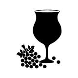 Silhouette cup wine with grapes Stock Photography