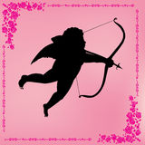 Silhouette of cupid with an arrow Stock Photo