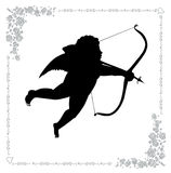 Silhouette of cupid with an arrow Stock Image