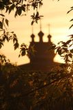 Wooden Saint George Church in Kolomenskoe, Moscow. The silhouette of cupolas of Wooden Saint George Church in Kolomenskoe against bright sunset sky royalty free stock images