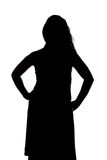 Silhouette of curvy woman with hands on hips Royalty Free Stock Photography