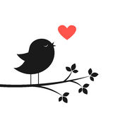 Silhouette of cute bird and red heart Stock Photos