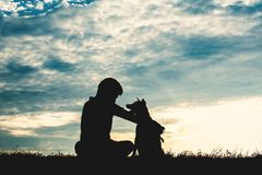 Free Silhouette Cute Boy And Dog Playing At Sky Sunset Stock Image - 118217891