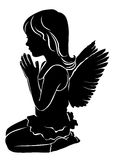 Silhouette cute little girl angel praying.  Royalty Free Stock Photo