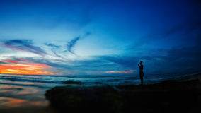 Silhouette of a cute little girl meditating Royalty Free Stock Photography