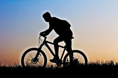A silhouette of a cyclist Stock Photos