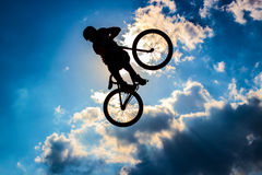 Silhouette of a cyclist on the background of sky Stock Images