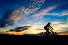 Silhouette of cyclist Stock Photos