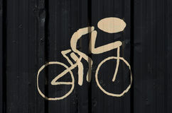 Silhouette of cyclist painted on black wall.  Royalty Free Stock Images