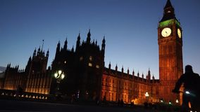 Silhouette of cyclist passing by big ben stock video footage