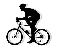 Silhouette of cyclist pedaling Stock Images