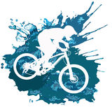 Silhouette of a cyclist riding a mountain bike Stock Image