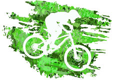Silhouette of a cyclist riding a mountain bike Stock Images