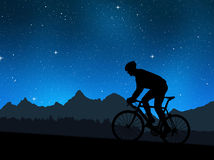 Silhouette of the cyclist. Riding a road bike in night Royalty Free Stock Images