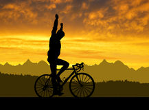 Silhouette of the cyclist riding a road bike Stock Photo