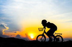 Silhouette of the cyclist riding a road bike Royalty Free Stock Photography