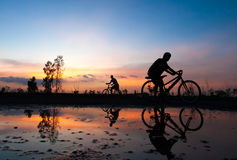 Silhouette cyclist sunset Stock Image