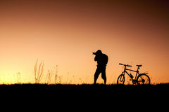 Silhouette of a cyclist with sunset background Royalty Free Stock Photography
