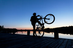 Silhouette of a Cyclist on the Sunset Sky Royalty Free Stock Photo